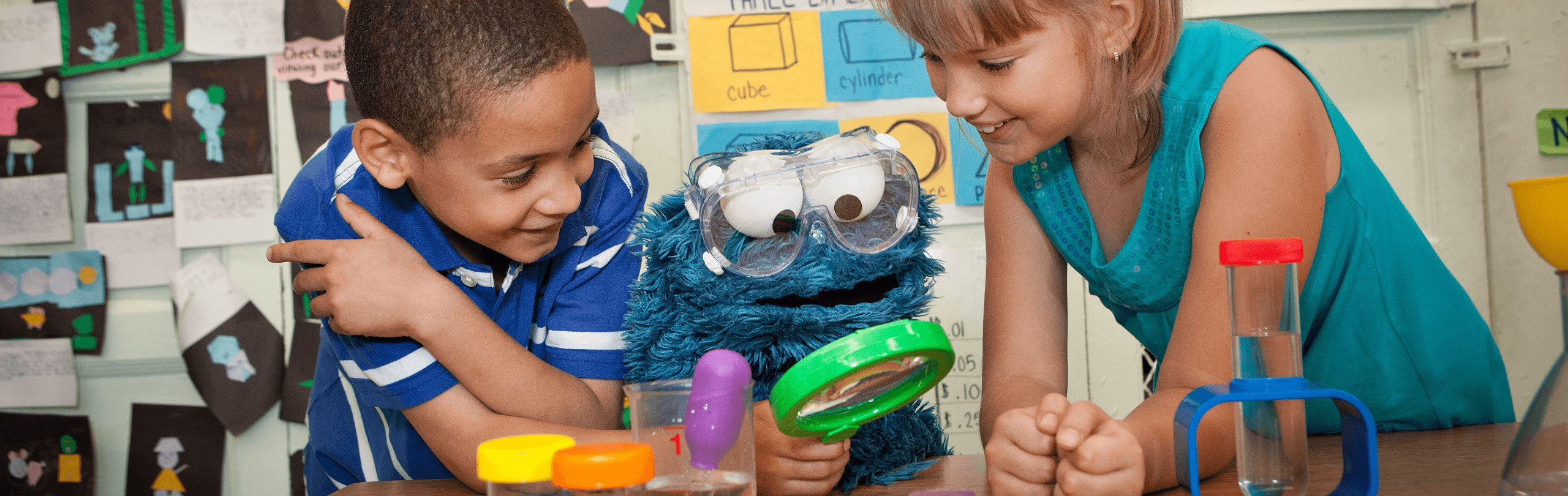 2 children with Cookie Monster doing science experiments
