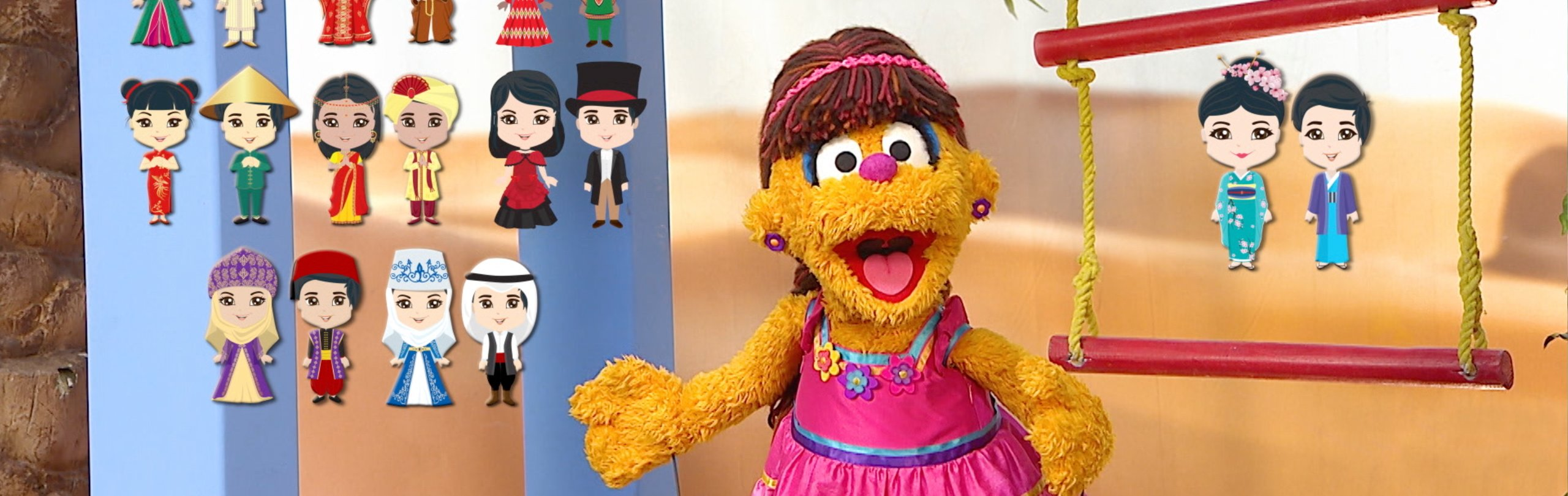A smiling female muppet looks at the camera