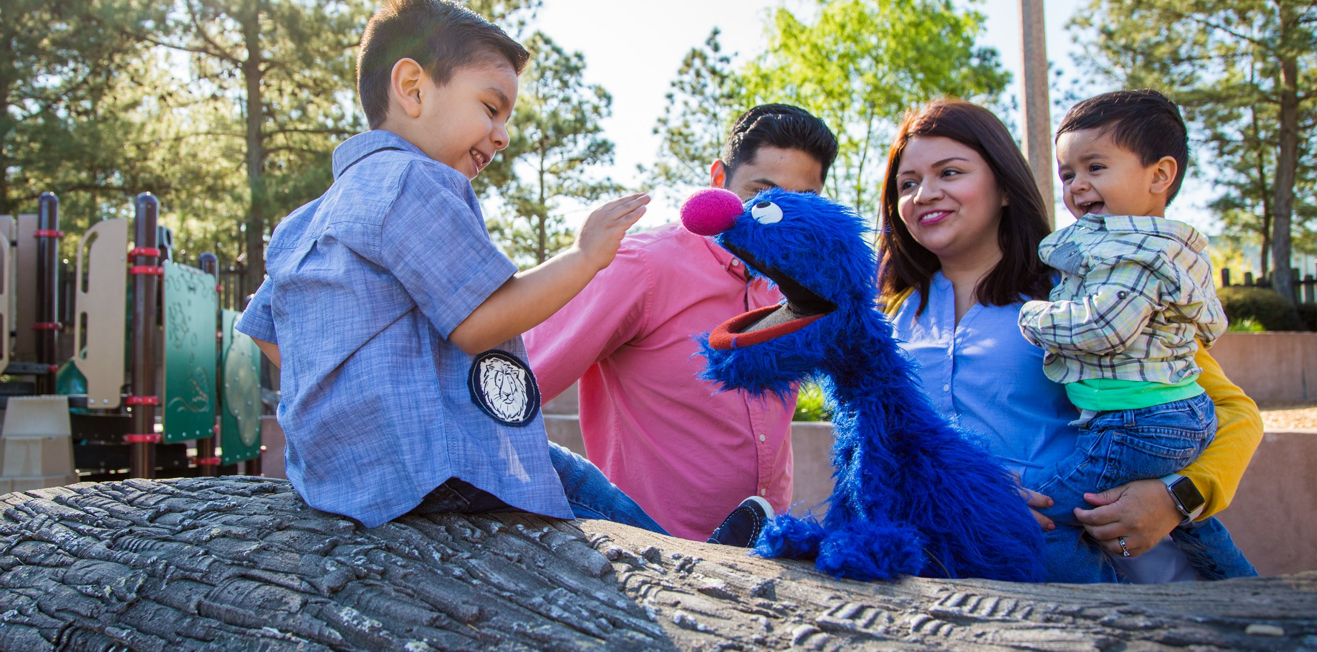 Boy smiling with Grover